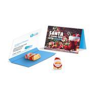Bigliettino pubblicitario con cioccolatino a forma di Babbo Natale
